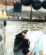 woman sticking head in fireplace oven