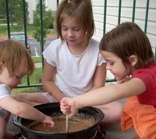 girls stirring refried beans